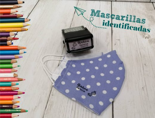 Mascarilla de tela marcada con nombre de niño con el sello textil